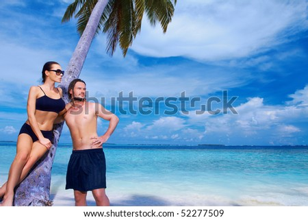 Romantic couple resting at Maldives seaside