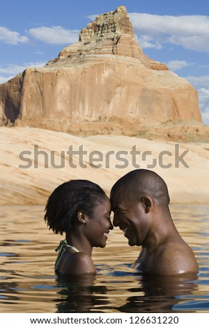 Romantic couple sharing affection - stock photo