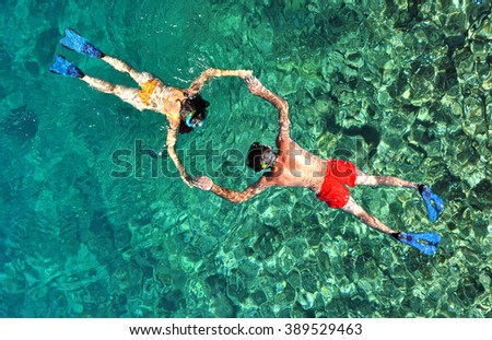 Romantic couple snorkeling. Above view