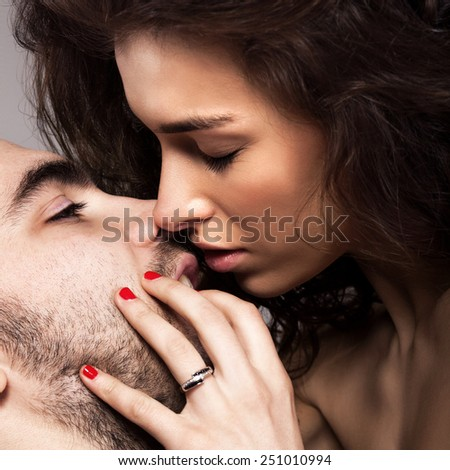 Romantic couple touching and kissing each other. Close-up of man and woman