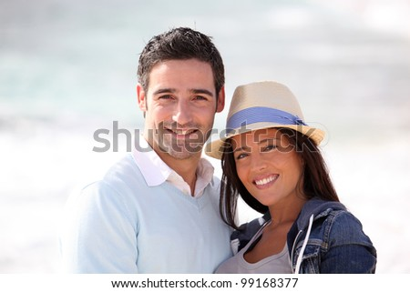 Romantic couple walking by the beach