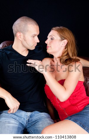romantic couple, with the woman working on seducing the man, with love in her eyes - stock photo