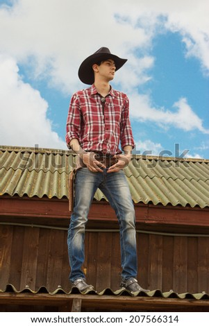 romantic cowboy on the roof - stock photo
