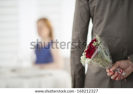 romantic dating at restaurant focus on flower bouquet