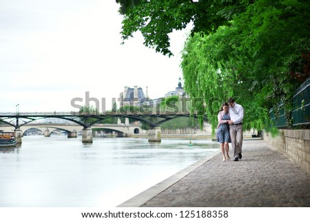 Romantic dating couple is walking by the water - stock photo