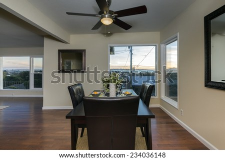Romantic decorated Dining Room Area with glimpse into sunset.  - stock photo