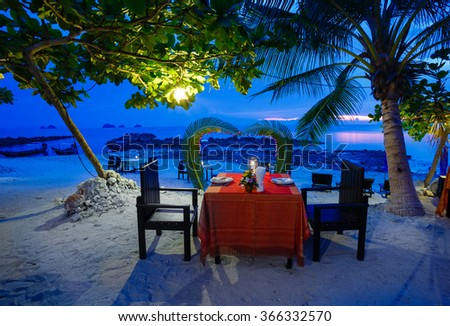 Romantic dinner, beach restaurant at sunset