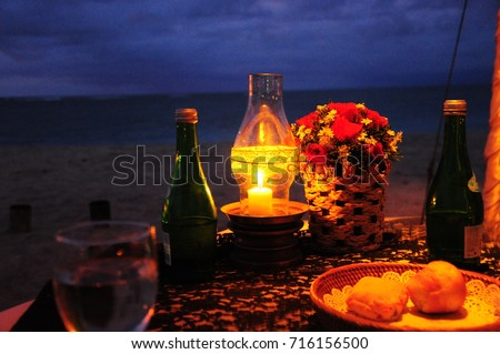 https://thumb1.shutterstock.com/display_pic_with_logo/167494286/716156500/stock-photo-romantic-dinner-by-beachside-in-bali-716156500.jpg
