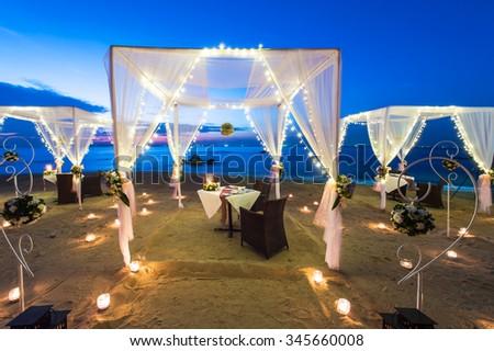 Romantic dinner on the beach. - stock photo