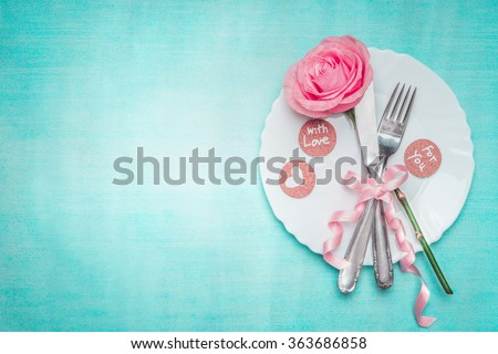 Romantic dinner table place setting with rose and sign decoration on blue background, top view. Valentines day and love concept. - stock photo