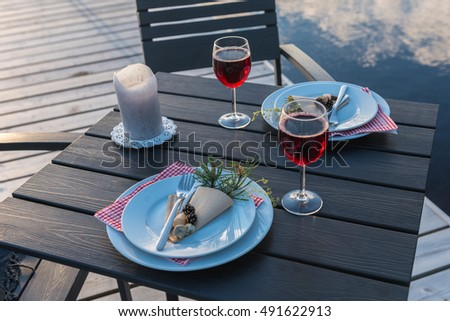 Romantic dinner with candles on the lake. Sunset, White Nights,  Nurmes, Finland, Europe