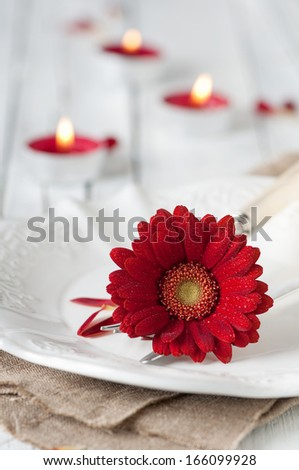 Romantic dinner with gerberas and candles, selective focus - stock photo