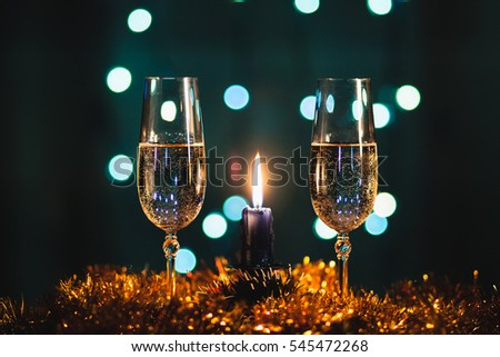 Romantic evening by candlelight with glass of champagne, nice cozy atmosphere