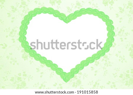 romantic floral background with green heart and copy space - stock photo