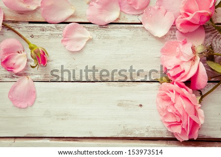 Romantic floral frame background/ Valentines day background/Pink roses on wooden background - stock photo