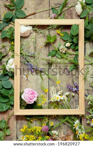 Romantic  frame with summer flowers on vintage wooden background