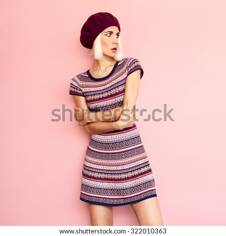 Romantic French style. Stylish Girl in a Beret and Dress burgundy color