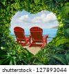 Romantic getaway and escape to a tropical beach vacation concept ash two red adirondack chairs with jungle plants in the shape of a love heart as a travel and traveling symbol for lovers and couples. - stock photo
