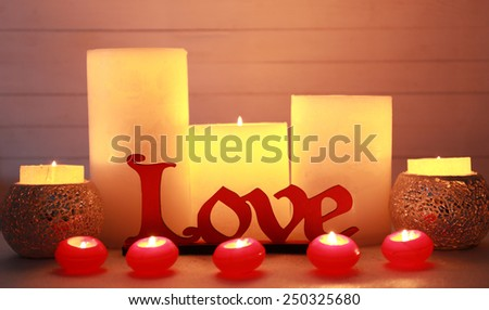 Romantic gift with candles, love concept - stock photo