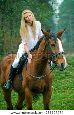 Romantic girl in a white horse. beautiful girl and a horse