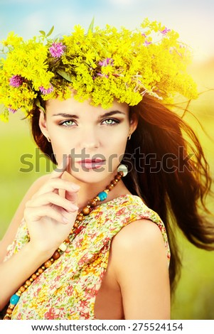 Romantic girl in a wreath of wild flowers in a field. Summer life. Beauty. - stock photo