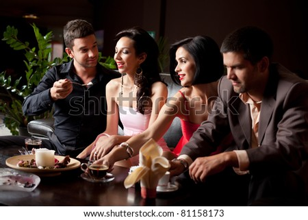 romantic glamourous couples sitting at coffee and dessert - stock photo