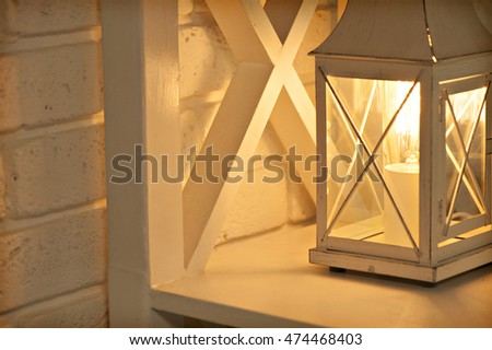 Romantic golden background with retro lamp and glare. selective focus