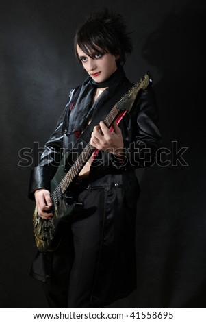 Romantic gothic boy playing guitar