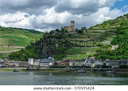 Romantic Gutenfels medieval castle at Kaub in the famous Rhine Gorge north of Rudesheim, Germany. The hills with the famous vineyards of the Rhine and medieval village on a sunny summer day. - stock photo