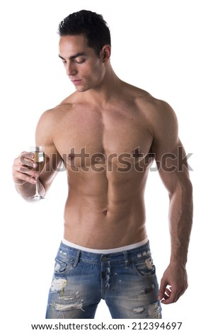 Romantic handsome muscular shirtless young man looking at a flute of sparkling champagne isolated on white