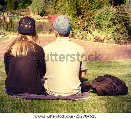 Romantic happy couple holding hands in park together  - stock photo
