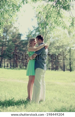 Romantic happy couple in love outdoors enjoying each other, date, wedding, relationships - concept - stock photo