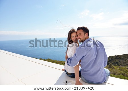 romantic happy young couple relax at modern home outdoors - stock photo