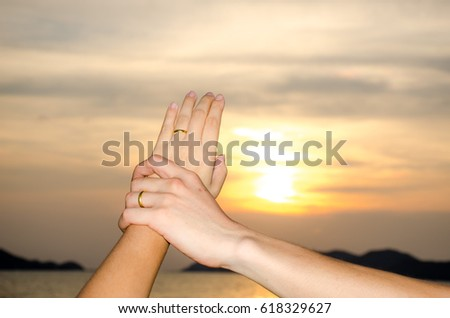 Romantic heart shaped couple love hand sing sunset beach background