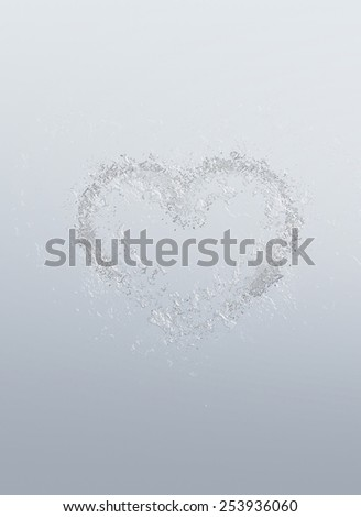 Romantic heart symbolic of love and romance formed of water bubbles over a graduated grey background for Valentines Day or anniversary wishes to a loved one - stock photo