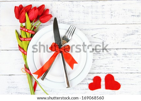 Romantic holiday table setting, on wooden background - stock photo