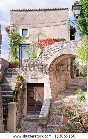 Romantic italian stone village, old stairway, door and arc. - stock photo