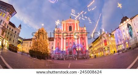 Romantic Ljubljana's city center decorated for Christmas holidays. Preseren's square, Ljubljana, Slovenia, Europe. Fish eye view of the whole square. - stock photo