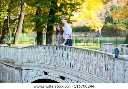 Romantic loveing couple on a bridge - stock photo