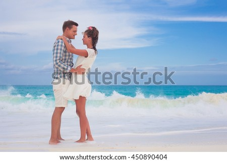 romantic lovers hugging at beach on Cayo Largo, Cuba