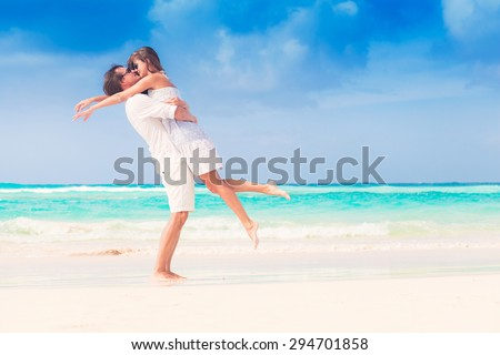 romantic lovers vacation on a tropical beach. honeymoon - stock photo