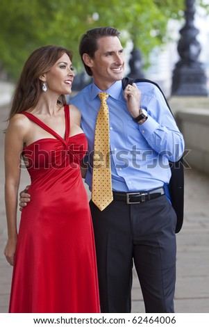 Romantic man and woman couple walking by the River Thames in London, England, Great Britain - stock photo