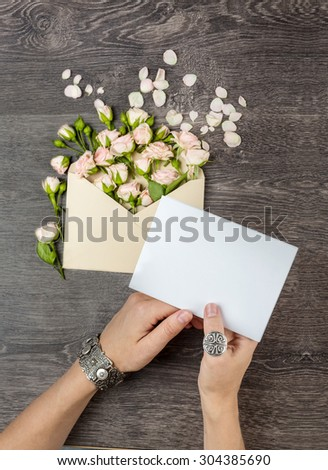 Romantic message for his beloved woman. Hands holding paper letter. Empty space for your text. Top view - stock photo