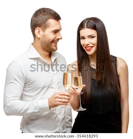 Romantic new year's eve fashion couple toasting with champagne. Isolated on white.