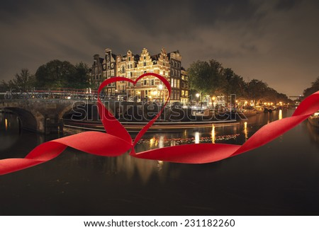 Romantic night view of Amsterdam, with red ribbon and heart - stock photo