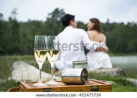 Romantic outdoor Celebration couple with Pair glass of champagne. the celebration theme of lover. - stock photo