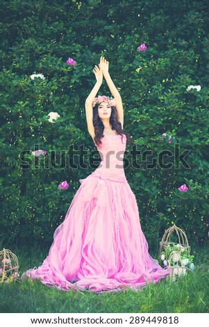 Romantic Outdoors Portrait of Fashion Woman on Greenery Background - stock photo