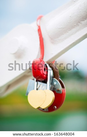 romantic padlock in heart shape on the bridge - stock photo