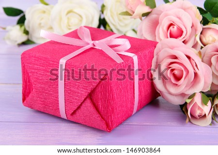 Romantic parcel on wooden background - stock photo