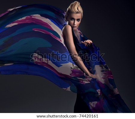Romantic photo of a blonde wearing colorful dress - stock photo
